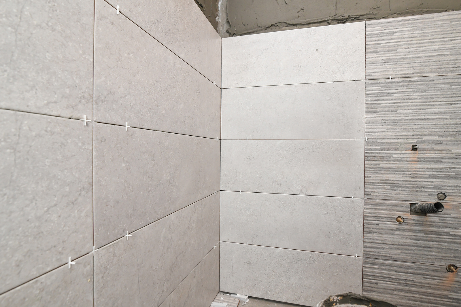 Repair the bathroom. Renovation at home unfinished ceramic tiles with spacers